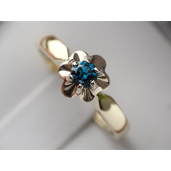 Gold ring with blue diamond...